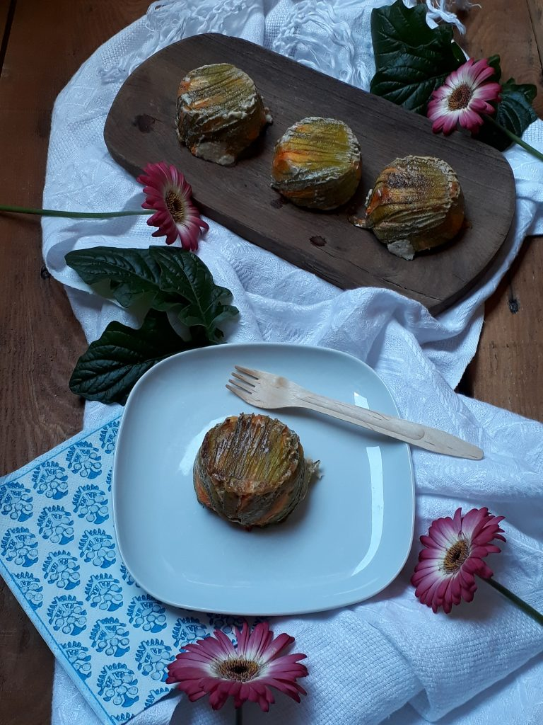 tortino con pomodori secchi ricotta e fiori di zucca